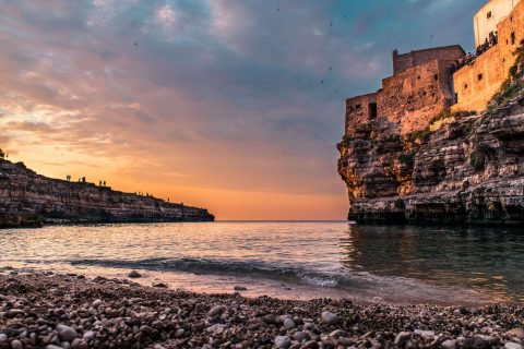 Sunset at Cala Monachile in Polignano a Mare