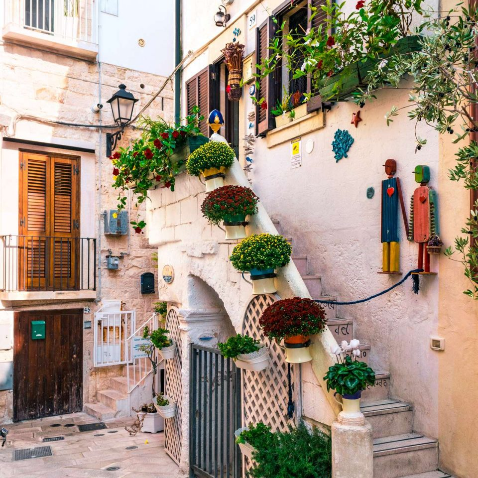 A colorful flowered street at Polignano a Mare | Cala Monachile | Puglia