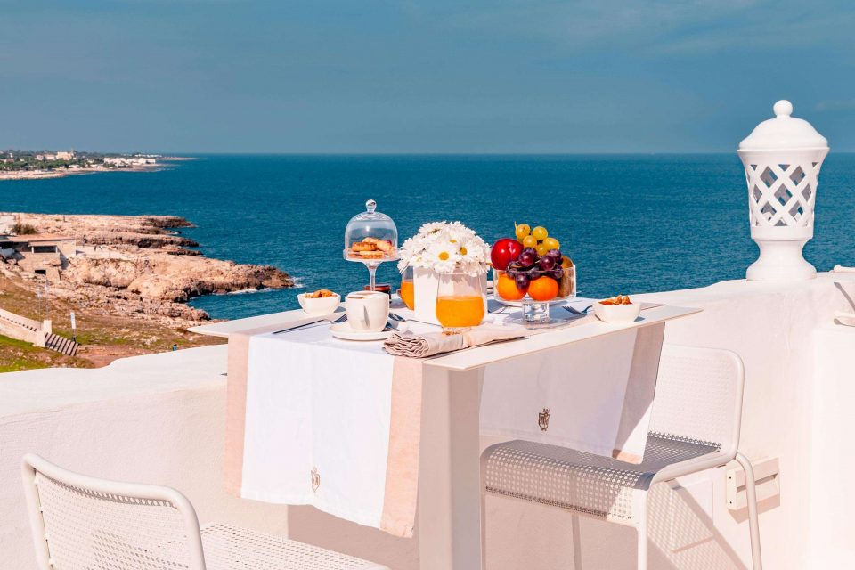 Breakfast served on the terrace which overlooks the sea at San Michele Suite with its luxury suites in Polignano a Mare