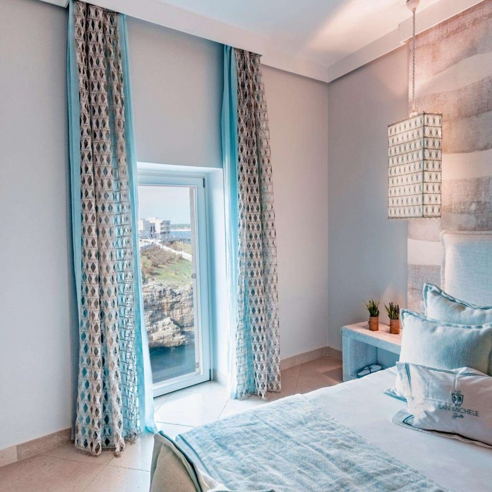 Detail of a bedroom in one of the luxury suites in Polignano a Mare which overlook the sea at San Michele Suite