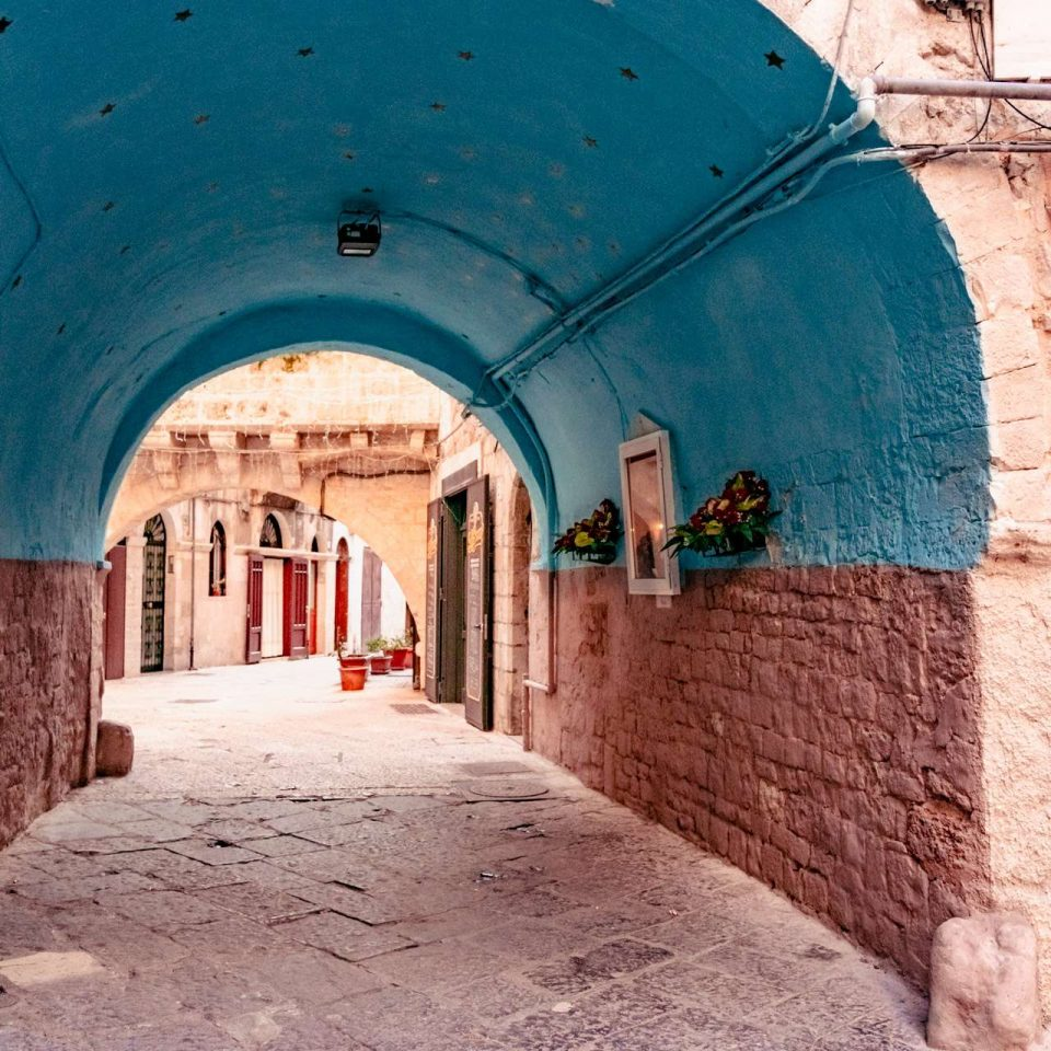 A blue arch in the old town of Bari city.