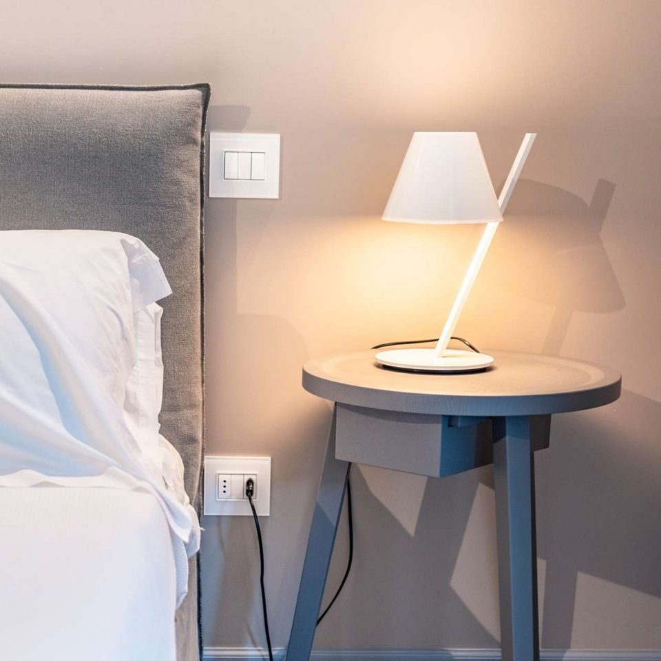 A detail of a bedroom in one of the five luxury flats at Cinquevite in Polignano a Mare | Puglia