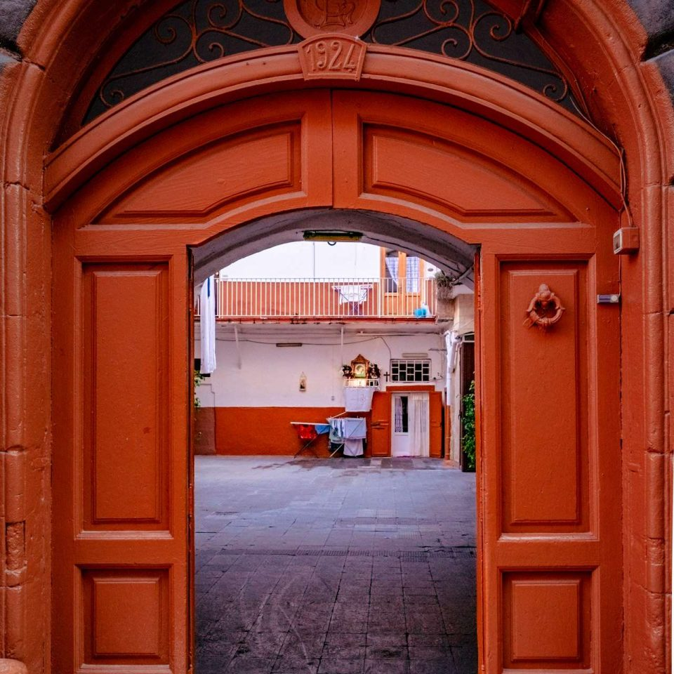 Detail of a deep orange door in the old town of Bari city.