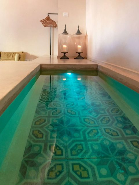 A detail of a private pool in the bedroom in one of the five luxury flats at Cinquevite in Polignano a Mare | Puglia