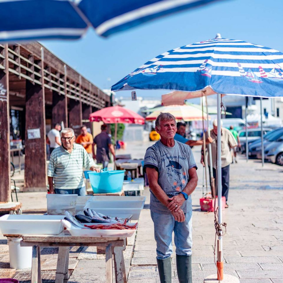 Fisherman at the fish market at the jetty Saint Nicholas in Bari