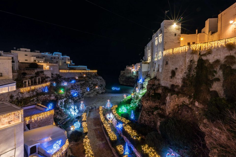 Christmas lights in Puglia panoramic view of Cala Monachine in Polignano a Mare