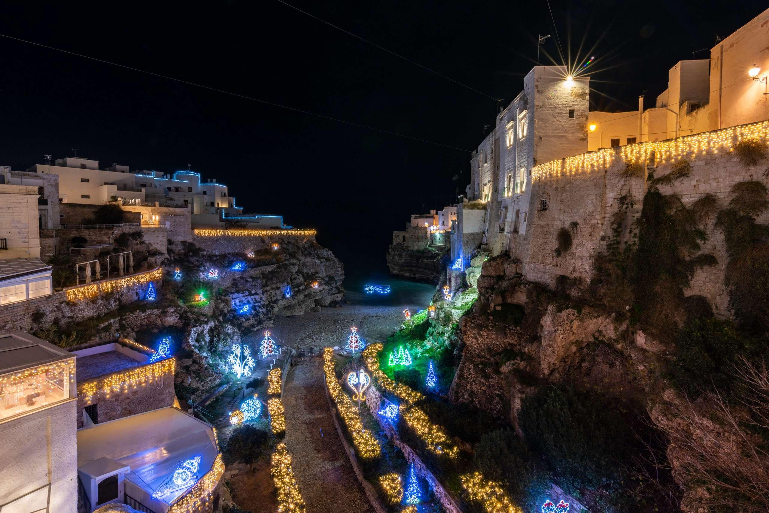 Christmas lights in Puglia panoramic view of Cala Monachine in Polignano a Mare