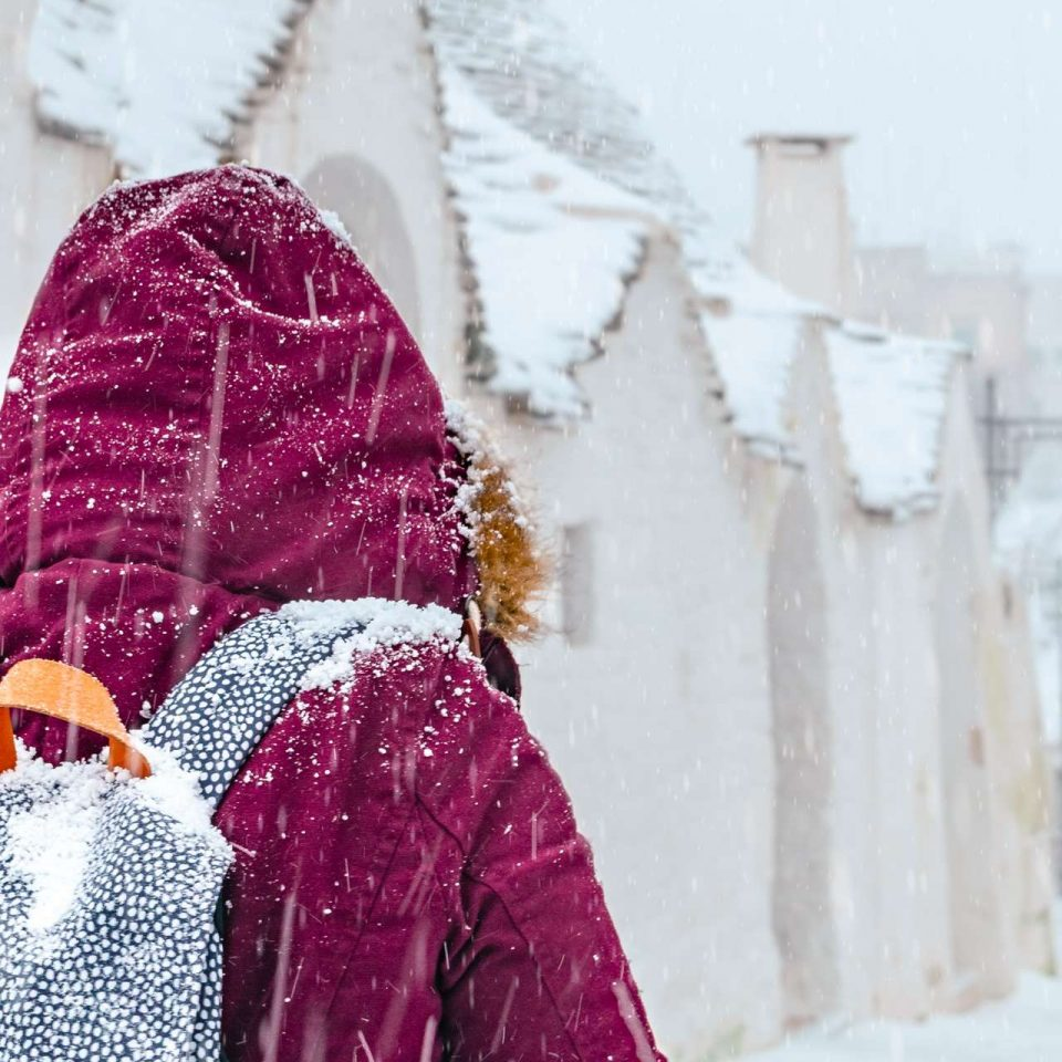 Daria in a snowy day at Alberobello, Puglia