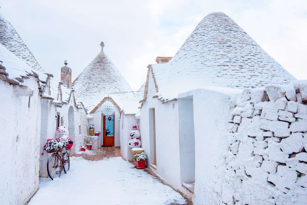 Snow on trulli in Alberobello, Puglia