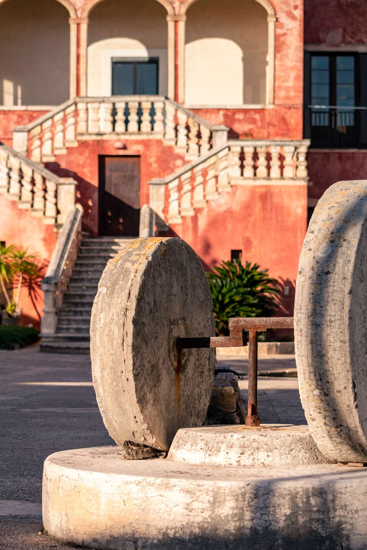 Old grindstone at Masseria Spina Resort in Puglia
