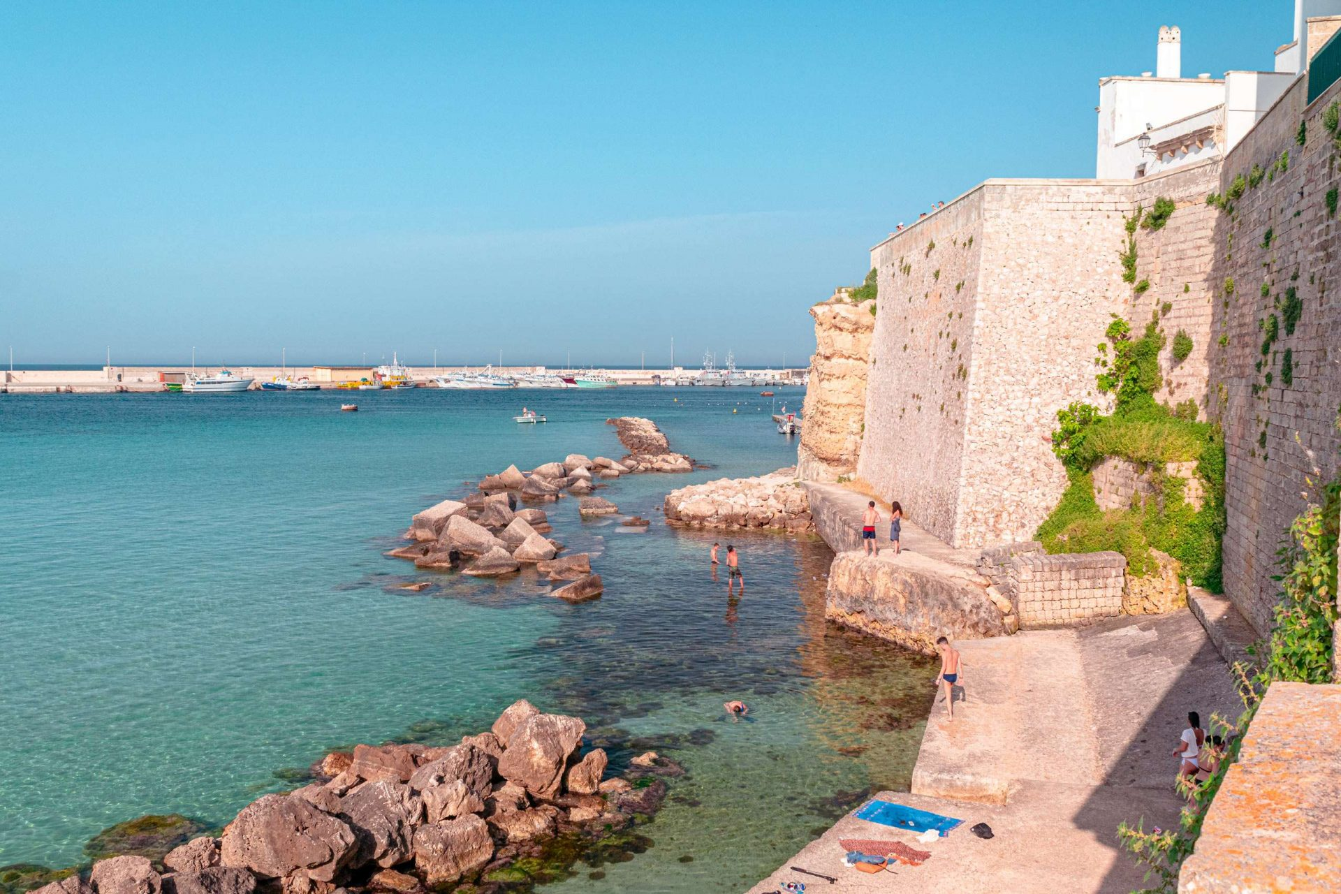 The beautiful sea of Otranto behind the town walls close to the Castle - stop-over of Road Trip in Salento
